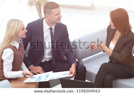 Manager and staff discussing the financial report. #1198204963