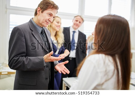 Manager and team negotiating in conference room #519354733