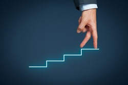 Manager (businessman, coach, leadership) has success and want to growth further. Growth and personal development represented by stairs.