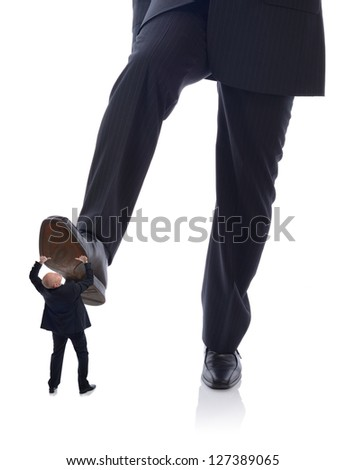 manager Businessman in suit stepping on employee isolated on white - stock photo