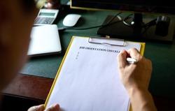 Manager going through job orientation checklist. An on boarding concept. Closeup view.