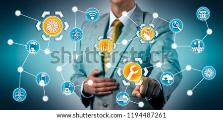 Manager initiating smart predictive maintenance application for a steam turbine via the industrial internet of things and artificial intelligence. Energy industry concept for digital transformation.