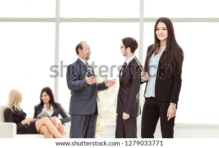 Manager of the company with documents on the background of the company's employees #1279033771