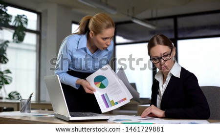 Manager reminding colleague about deadline, angry about charts with low revenues #1461729881