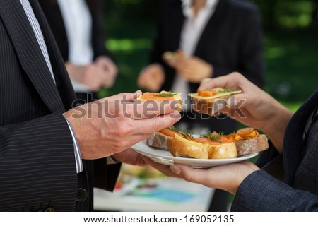 Manager\'s conversations at the office buffet during lunch