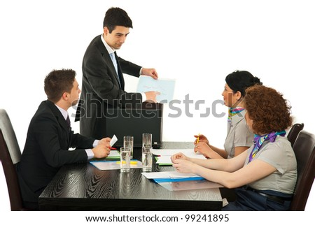 Manager showing diagram to his team at meeting against white background