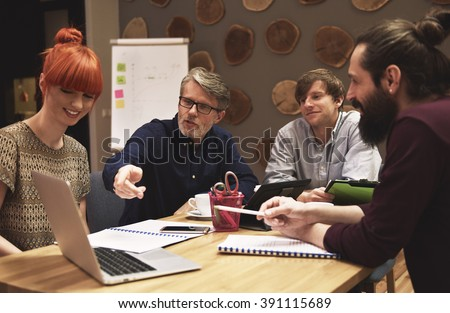 Manager showing idea for finding new customers