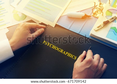 Manager taking book with name psychographics.
