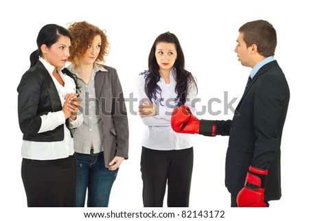Manager wearing boxing gloves and having conflict with his employees women against white background