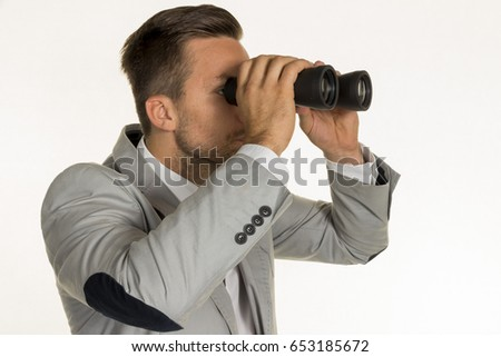 manager with binoculars #653185672