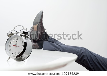 manager with feet on desk at noon