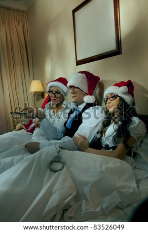 Manager with two his subordinates watching tv on New Year\'s night
