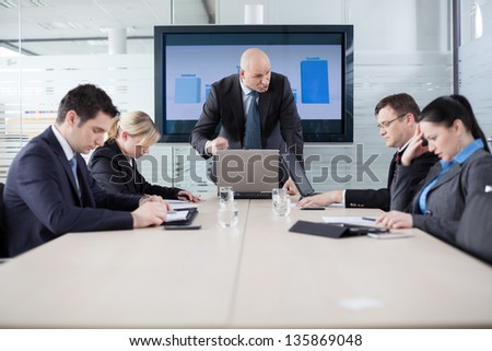 Manager yelling at his employees at the meeting. Company is in recession.