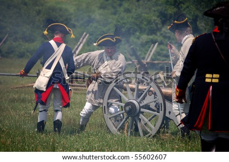 MANALAPAN, NJ - JUNE 19: Continental artillery men clean their weapon on the battlefield at the 2010 re-enactment of the Battle of Monmouth on June 19, 2010 in Manalapan, NJ.