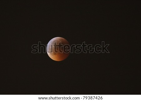 MANAMA, BAHRAIN - APRIL 15-16: Longest lunar eclipse of decade with partial, total and mid eclipse phases observed on June 15-16, 2011 in the sky of Manama, Bahrain. Total eclipse 16 June at 00:01