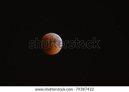 MANAMA, BAHRAIN - APRIL 15-16: Longest lunar eclipse of decade with partial, total and mid eclipse phases observed on June 15-16, 2011 in the sky of Manama, Bahrain. Total eclipse 15 June at 22:24