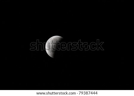MANAMA, BAHRAIN - APRIL 15-16: Longest lunar eclipse of decade with partial, total and mid eclipse phases observed on June 15-16, 2011 in the sky of Manama, Bahrain. Partial eclipse 16 June at 00:35