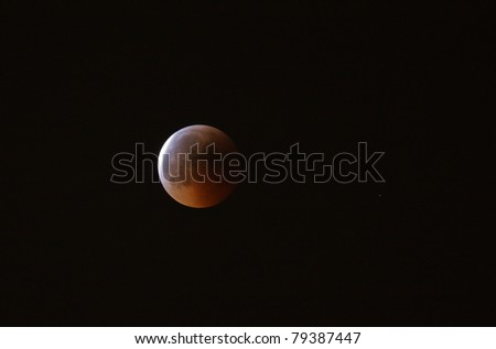 MANAMA, BAHRAIN - APRIL 15-16: Longest lunar eclipse of decade with partial, total and mid eclipse phases observed on June 15-16, 2011 in the sky of Manama, Bahrain. Partial eclipse 16 June at 00:08