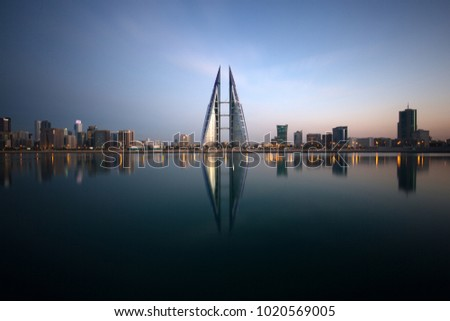 MANAMA, BAHRAIN - FEBRUARY 05: The Bahrain World Trade Center during dusk, a twin tower complex is the first skyscraper in the world to have wind turbines, February 05, 2018, Manama, Bahrain   #1020569005