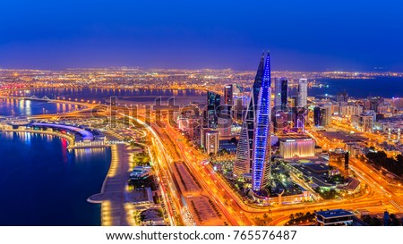 Manama, Bahrain - November 04, 2017: Panoramic view of Bahrain World Trade Centre building, Avenue mall and manama city at blue hour #765576487
