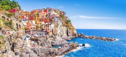 Manarola, Italy - iconic landmark village in Cinque Terre national park in Italy, Ligury, nearby Spezia city. UNESCO world heritage site. Manarola is famous and popular travel destination.
