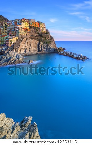 Manarola town on cliff rocks and sea at sunset., Seascape in Five lands, Cinque Terre National Park, Liguria Italy Europe.