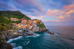 Manarola village popular european italian tourist destination in Cinque Terre National Park UNESCO World Heritage Site, Liguria, Italy on sunset