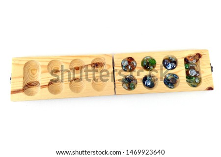 mancala game set, a game mancala of african origin, wooden mancala game set on white back ground, #1469923640