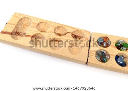 mancala game set, a game mancala of african origin, wooden mancala game set on white back ground, #1469923646