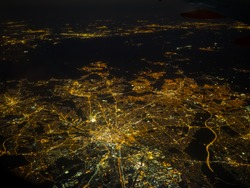 Manchester City at night showing power grid from airplane window