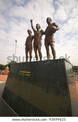 MANCHESTER, ENGLAND - JUNE 4: The Statue of The Holy Trinity in front of The Old Trafford stadium on June 4 ,2009 in Manchester, England. Old Trafford is home of Manchester United football club