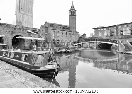 Manchester UK. Castlefield district, waterway canal area with a narrowboat.