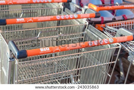 Manchester, UK - January 5th 2015: B&Q Shopping trolleys or carts with health and safety instructions. One of the largest UK DIY retailers, the health and safety of its customers is a key concern.