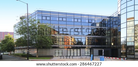 MANCHESTER, UK - JUNE 6, 2015: Office building. Manchester City Council hopes that Home will boost the economy by attracting other businesses to this part of the city centre.