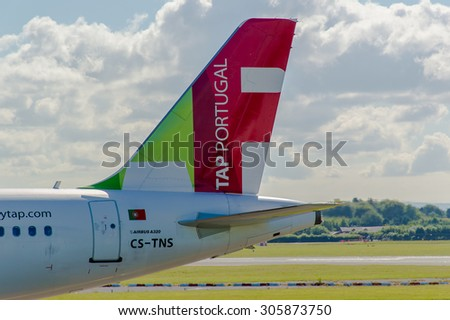 MANCHESTER, UNITED KINGDOM - AUG 07, 2015: Air Portugal (TAP) Airbus A320 tail livery at Manchester Airport Aug 07 2015.