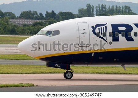 Manchester, United Kingdom - June 14, 2014: Ryanair Boeing 737 at Manchester International Airport. On August 2015, Ryanair is having talks with IAG and other carriers about long haul transfers.