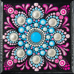 Mandala dot art painting on wood tiles. Beautiful mandala hand painted by colorful dots on black wood. National patterns with acrylic paints, handwork, dot painting. Abstract dotted background.