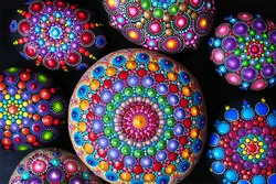 Mandala dot painting colorful stones background