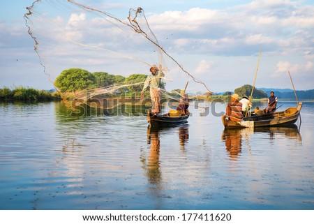 Mandalay - December 3: Fishermen Catch Fish December 3, 2013 In Mandalay. Fishermen Show Ancient Way Of Fishing Nets