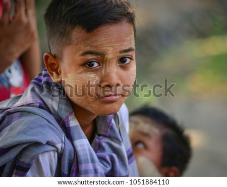 Mandalay, Myanmar - Feb 11, 2017. Portrait of Burmese boy at the village in Mandalay, Myanmar. #1051884110