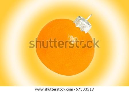 Mandarin as a Christmas ball - stock photo