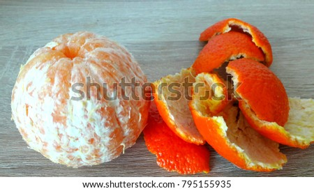Mandarin cleansed and peeled on a wooden background peeled and peeled on a wooden background #795155935