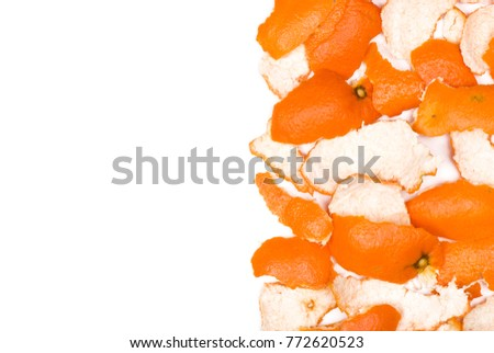 Mandarin peels. Mandarin peels on a blank (white) background, arranged on right side, with copy space. Top view. #772620523