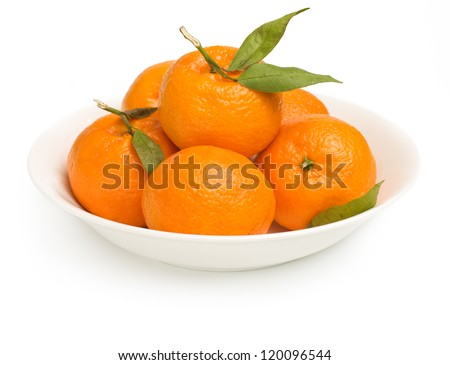 mandarin / tangerine / clementines in bowl isolated on white background with shadow