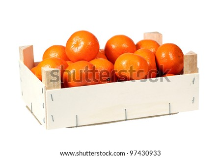 Mandarins in wooden box isolated over white with clipping path