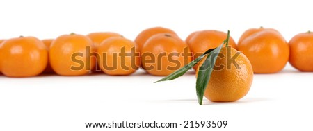Mandarins, standing out from the crowd concept, isolated over white