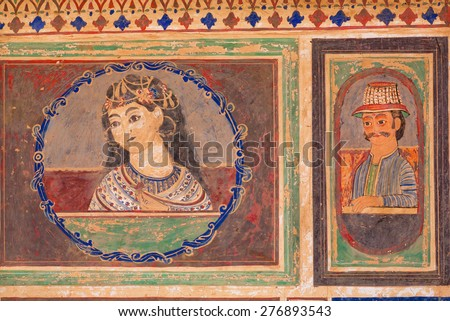 MANDAWA, INDIA - FEB 7: Lady with flower and man in a hat on a rustic fresco by unknown artist on February 7, 2015. With populat. of 21000, Mandawa is a touristic site with its naive art Haveli houses