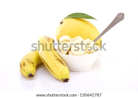 Mango and bananas on white