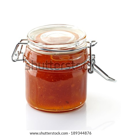 Mango Chutney in a jar isolated on a white background