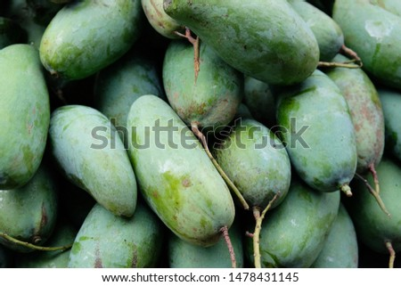 Mango has a ripe green shell with a sour taste.